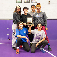 The Miyamura Lady Patriots wrestling team pose for a photo with their 2019-2020 Girls Wrestling District Champions trophy Tuesday afternoon at Miyamura High School. The Lady Patriots are seeded #1 in the state and will compete at the New Mexico Athletic Association state wrestling tournament this weekend at the Santa Ana Star Center in Rio Rancho.