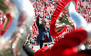 Rock and roll musician Steve Miller directs the Wisconsin Marching Band in the 5th quarter after Wisconsin beat Maryland 38-13. (AP Photo/Andy Manis)