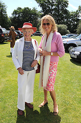 Left to right, EVE BRANSON and VISCOUNTESS COWDRAY at a Pro-Celebrity Polo match in aid of the Mark Davies Injured Riders Fund Charity Day held at Cowdray Park, West Sussex on 22nd June 2008.<br />