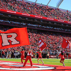 Oct 13, 2012: Rutgers Scarlet Knights cheerleaders wave flags following a Rutgers touchdown during NCAA Big East college football action between the Rutgers Scarlet Knights and Syracuse Orange at High Point Solutions Stadium in Piscataway, N.J.