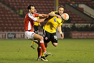 Jose Baxter is fouled during the Sky Bet League 1 match between Walsall and Sheffield Utd at the Banks's Stadium, Walsall, England on 17 March 2015. Photo by Alan Franklin.