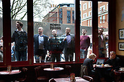 London Wednesday 17th April 2013. The funeral of former Prime Minister Baroness Margaret Thatcher. Members of the public eager for a view looking through the window of Cafe Rouge at St Paul's.