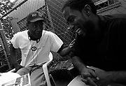 """Tyron Gamble, right, gets advice from a """"veteran"""" of the Seattle streets. Camble had just arrived in Seattle on a bus ticket provided by the State of Florida, where he was just released from penitentiary."""