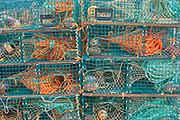 Lobster traps in coastal fishing village.<br />