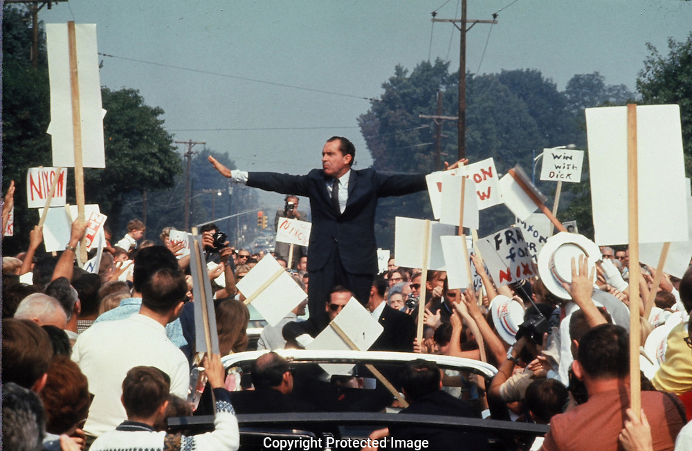 Richard Nixon in campaign motorcade near the King of Prussia Mall  Philadelphia PA on one of the final days of the campaign in October 1968..Photograph by Dennis Brack BBBs 20