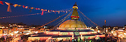 Boudhanath Stupa is decorated with colorful lights as worshippers gather for Buddha Jayanti (Buddha's birthday) on May 9, 2009 in Kathmandu, Nepal.