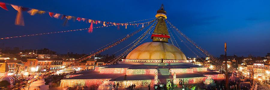 Boudhanath Stupa is decorated with colorful lights as worshippers gather for Buddha Jayanti (Buddha's birthday) on May 9, 2009 in Kathmandu, Nepal.