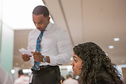 Purchase, NY – 31 October 2014. Lincoln High School team member Paola Ferreira, right, listening to a team member while Morgan Stanley facilitator Ahkiel White reviews his case notes.The Business Skills Olympics was founded by the African American Men of Westchester, is sponsored and facilitated by Morgan Stanley, and is open to high school teams in Westchester County.
