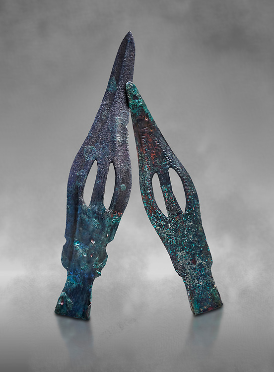 Hittite bronze spear heads. Hittite Period 1650 - 1450 BC, Ortakoy Sapinuva . Çorum Archaeological Museum, Corum, Turkey. Against a grey bacground. .<br />  <br /> If you prefer to buy from our ALAMY STOCK LIBRARY page at https://www.alamy.com/portfolio/paul-williams-funkystock/hittite-art-antiquities.html  - Alaca Hoyuk   into the LOWER SEARCH WITHIN GALLERY box. Refine search by adding background colour, place, museum etc<br /> <br /> Visit our HITTITE PHOTO COLLECTIONS for more photos to download or buy as wall art prints https://funkystock.photoshelter.com/gallery-collection/The-Hittites-Art-Artefacts-Antiquities-Historic-Sites-Pictures-Images-of/C0000NUBSMhSc3Oo