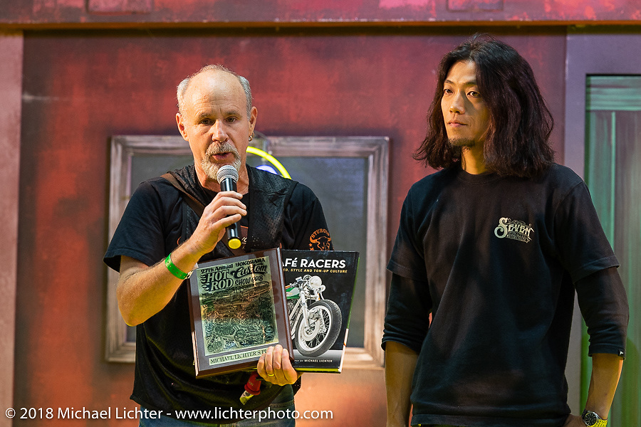 Michael Lichter giving the Michael LIchter Mooneyes Award to custom bike builder Takatoshi Suzuki of Seven Motorcycles at the 27th Annual Mooneyes Yokohama Hot Rod Custom Show 2018. Yokohama, Japan. Sunday, December 2, 2018. Photography ©2018 Michael Lichter.