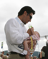 26 August 2007: Los Angeles Dodgers infielder Nomar Garciaparra, husband of 2007 inductee Mia Hamm (not pictured), feeds daughter Grace before the ceremony. The National Soccer Hall of Fame Induction Ceremony was held at the National Soccer Hall of Fame in Oneonta, New York.