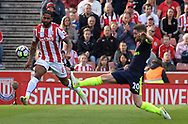 Glenn Johnson of Stoke battles with Shkodran Mustafi of Arsenal. Premier league match, Stoke City v Arsenal at the Bet365 Stadium in Stoke on Trent, Staffs on Saturday 13th May 2017.<br /> pic by Bradley Collyer, Andrew Orchard sports photography.