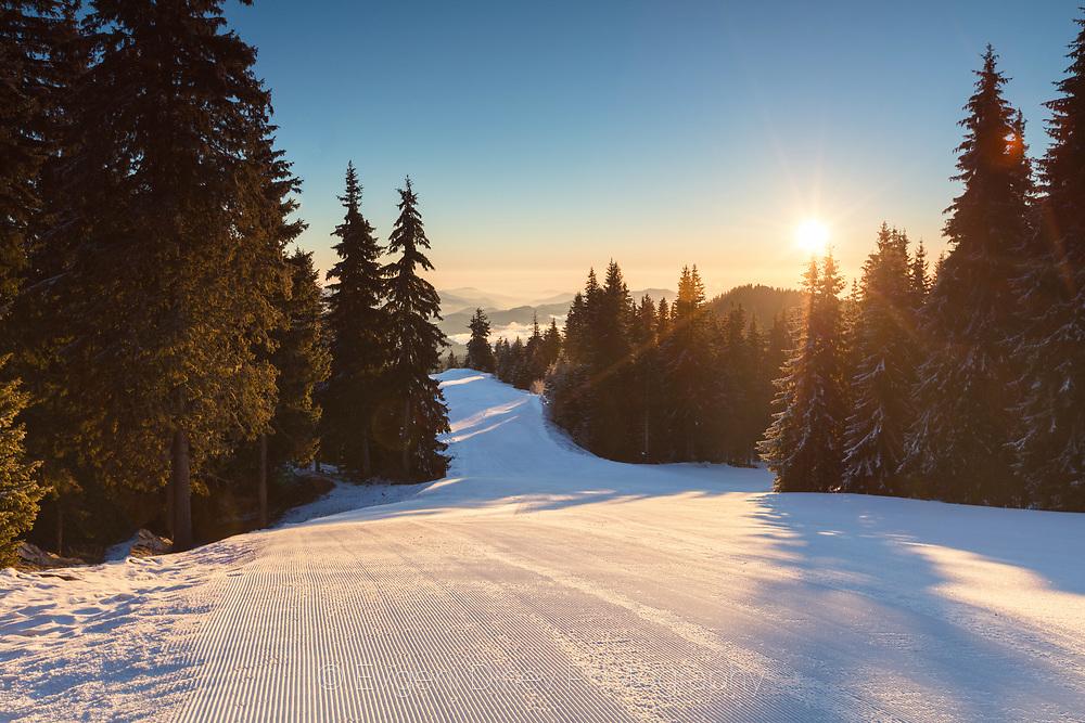 Clean ski run in the mountain at sunrise