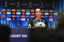 CARDIFF, WALES - Tuesday, August 12, 2014: Sevilla's head coach Unai Emery during a press conference ahead of the UEFA Super Cup at Cardiff City Stadium.  (Pic by Pool/Getty Images/Propaganda)