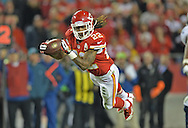 KANSAS CITY, MO - DECEMBER 01:  Wide receiver Dexter McCluster #22 of the Kansas City Chiefs makes a diving catch against the Denver Broncos during the second half on December 1, 2013 at Arrowhead Stadium in Kansas City, Missouri.  Denver beat Kansas City 35-28.  (Photo by Peter Aiken/Getty Images) *** Local Caption *** Dexter McCluster