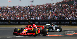 Ferrari's Sebastian Vettel leads Mercedes Lewis Hamilton in the 2018 British Grand Prix at Silverstone Circuit, Towcester.