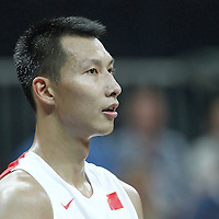 31 July 2012: China Jianlin Yi rests during the 73-54 Russia victory over China, during the men's basketball preliminary, at the Basketball Arena, in London, Great Britain.