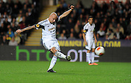 Jonjo Shelvey has a shot on goal for Swansea City.<br /> UEFA Europa league match, Swansea city v FC Kuban Krasnodar at the Liberty Stadium in Swansea, South Wales on Thursday 24th October 2013. pic by Phil Rees, Andrew Orchard sports photography,