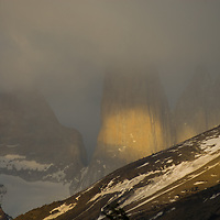 Morning clouds billow over the Towers of Paine in Torres del  Paine National Park in Patagonia, Chile