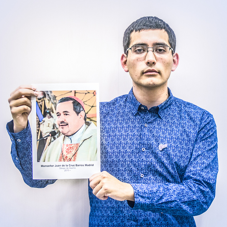 2018<br /> Juan Carlos Claret, a survivor and activist from Chile, poses for a portrait showing a picture of the Chilean bishop Juan de la Cruz Barros Madrid who covered up Fernando Caradima sexual abuses on seminarists, children and priests. © Simone Padovani