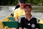 Nasir, an Iban guide in a longboat in Ulu Temburong National Park, Brunei