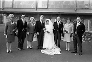 """16/09/1967<br /> 09/16/1967<br /> 16 September 1967<br /> Wedding of Mr Francis W. Moloney, 28 The Stiles Road, Clontarf and Ms Antoinette O'Carroll, """"Melrose"""", Leinster Road, Rathmines at Our Lady of Refuge Church, Rathmines, with reception in Colamore Hotel, Coliemore Road, Dalkey. Image shows the Bride and Groom with Groom's party."""