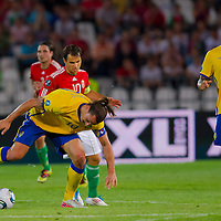 Sweden's Zlatan Ibrahimovic (front) fights for the ball with Hungary's Tamas Hajnal (back) during the UEFA EURO 2012 Group E qualifier Hungary playing against Sweden in Budapest, Hungary on September 02, 2011. ATTILA VOLGYI