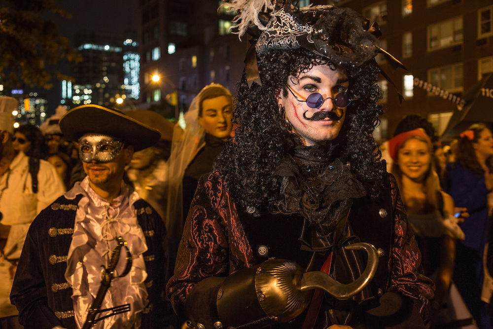 New York, NY, October 31, 2013. A man wearing a Captain Hook costume is followed by a pirate in New York's Greenwich Village Halloween Parade.