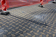 The shadow from construction netting on a pedestrian pavement in the Slovenian capital, Ljubljana, on 25th June 2018, in Ljubljana, Slovenia.