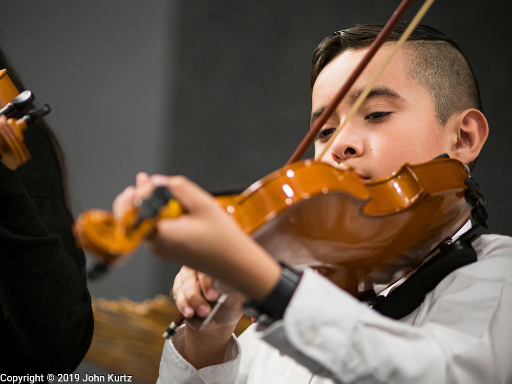 11 DECEMBER 2019 - DES MOINES, IOWA: A young violin player with the OLOA (Our Lady of the Americas) Mariachis performs during the Virgin of Guadalupe celebration at Our Lady of the Americas Catholic Church in Des Moines. Virgin of Guadalupe Day is one of the most important holy days in Mexican Catholicism. It marks Dec. 12, 1531, the day Juan Diego, an indigenous Mexican peasant, saw an apparition of the Virgin Mary on a barren hillside in what is now Mexico City. A basilica was built on the site. Virgin of Guadalupe Day is celebrated throughout Mexico and in Mexican communities in the United States.               PHOTO BY JACK KURTZ
