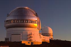 Gemini Northern Telescope and University of Hawaii 2.2-meter Telescope at sunset, Mauna Kea Observatories, Big Island, Hawaii
