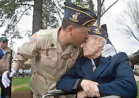 Dennis Lamb, left, kisses his grandfather and World War II veteran Tom Lamb, 87, after Memorial Day ceremonies at the Town Square. The younger Lamb served with the 3rd Infantry of the U.S. Army during Operation Desert Storm.