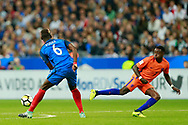 France's midfielder Paul Pogba tackles Netherlands' forward Quincy Promes during the FIFA World Cup Russia 2018, Qualifying Group A football match between France and Netherlands on August 31, 2017 at the Stade de France in Saint-Denis, north of Paris, France - Photo Benjamin Cremel / ProSportsImages / DPPI