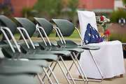An empty chair covered with a white cloth, a folded American Flag, and a single red rose is dedicated to the United States service members who have fallen during their service during the Milpitas Memorial Day Ceremony at Veterans Memorial Flag Plaza in Milpitas, California, on May 27, 2013. (Stan Olszewski/SOSKIphoto)