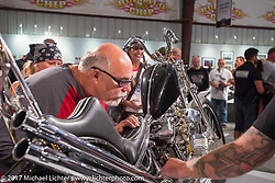 Custom builder Dave Perewitz checks out Christian Newman's Knucklehead in the the Old Iron - Young Blood exhibition media and industry reception in the Motorcycles as Art gallery at the Buffalo Chip during the annual Sturgis Black Hills Motorcycle Rally. Sturgis, SD. USA. Sunday August 6, 2017. Photography ©2017 Michael Lichter.