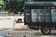 Yangon, Myanmar - November 15, 2011: Riot police shields hang from a truck parked outside the Shwedagon Pagoda in Yangon.