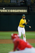 Oakland Athletics shortstop Marcus Semien (10) throws the ball to home plate to stop a Los Angeles Angels run at Oakland Coliseum in Oakland, California, on September 5, 2017. (Stan Olszewski/Special to S.F. Examiner)