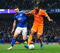 Blackpool's Nathan Delfouneso vies for possession with Ipswich Town's Gwion Edwards<br /> <br /> Photographer Chris Vaughan/CameraSport<br /> <br /> The EFL Sky Bet League One - Ipswich Town v Blackpool - Saturday 23rd November 2019 - Portman Road - Ipswich<br /> <br /> World Copyright © 2019 CameraSport. All rights reserved. 43 Linden Ave. Countesthorpe. Leicester. England. LE8 5PG - Tel: +44 (0) 116 277 4147 - admin@camerasport.com - www.camerasport.com