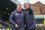 AFC Wimbledon manager Wally Downes laughing and AFC Wimbledon first team coach Glyn Hodges pointing during the EFL Sky Bet League 1 match between Southend United and AFC Wimbledon at Roots Hall, Southend, England on 16 March 2019.
