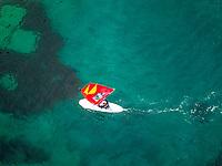 Aerial view of man practicing kitesurfing at transparent water, Croatia.