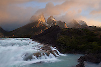 A small cascade overshadowed by the brilliance of a Patagonian sunrise in Southern Chile