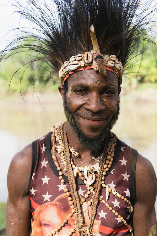Portrait of Benjamin Endamai, from Yaut village, photographed beside the Keram River in Yar village, East Sepik Province, Papua New Guinea. He was visiting Yar to participate in the dedication of the Waran New Testament.<br /> <br /> (June 21, 2019)