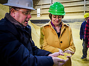 12 APRIL 2019 - NEVADA, IOWA: MIKE HOLLENBERG, CEO of Lincolnway Energy, (left), and US Senator AMY KLOBUCHAR, (D-MN) look at corn that will be turned into ethanol during a tour of the Lincolnway Energy ethanol plant in Nevada, IA. Sen. Klobuchar is touring Iowa this weekend to support her bid for the Democratic nomination of for the US Presidency. Iowa traditionally hosts the the first election event of the presidential election cycle. The Iowa Caucuses will be on Feb. 3, 2020.           PHOTO BY JACK KURTZ