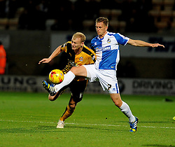 Lee Mansell of Bristol Rovers challenges Sam Beasant of Cambridge United - Mandatory byline: Neil Brookman/JMP - 07966 386802 - 30/10/2015 - FOOTBALL - The Abbey Stadium - Cambridge, England - Cambridge United v Bristol Rovers - Sky Bet League Two