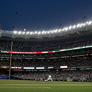 NEW YORK, NEW YORK - July 17: Pitcher Masahiro Tanaka #19 of the New York Yankees pitching as the moon rises over Yankee Stadium during the Boston Red Sox Vs New York Yankees regular season MLB game at Yankee Stadium on July 17, 2016 in New York City. (Photo by Tim Clayton/Corbis via Getty Images)