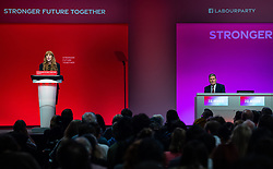 © Licensed to London News Pictures. 25/09/2021. Brighton, UK. ANGELA RAYNER delivers the Deputy Leader's speech at the conference as leader SIR KEIR STARMER listens . The first day of the 2021 Labour Party Conference , which is taking place at the Brighton Centre . Photo credit: Joel Goodman/LNP