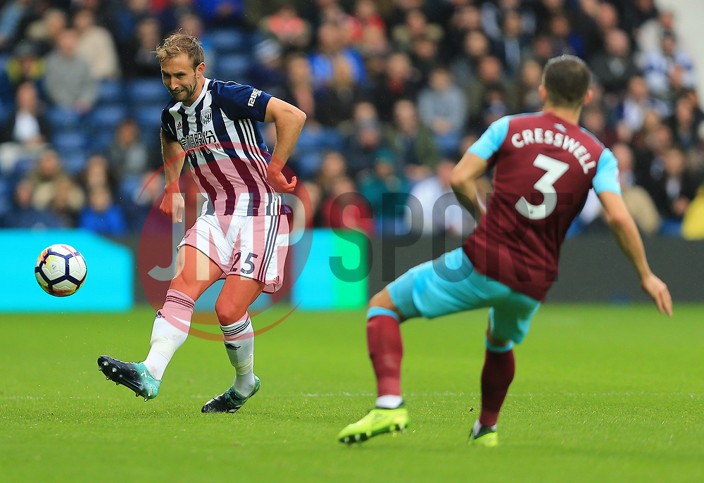 Craig Dawson of West Bromwich Albion chips past Aaron Cresswell of West Ham United - Mandatory by-line: Paul Roberts/JMP - 16/09/2017 - FOOTBALL - The Hawthorns - West Bromwich, England - West Bromwich Albion v West Ham United - Premier League