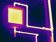 Thermogram of steam pipes for a hot water heating system.  The different colors represent different temperatures on the object. The lightest colors are the hottest temperatures, while the darker colors represent a cooler temperature.  Thermography uses special cameras that can detect light in the far-infrared range of the electromagnetic spectrum (900?14,000 nanometers or 0.9?14 µm) and creates an  image of the objects temperature..