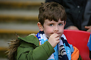 A young Manchester City fan during the The FA Cup semi-final match between Manchester City and Brighton and Hove Albion at Wembley Stadium, London, England on 6 April 2019.