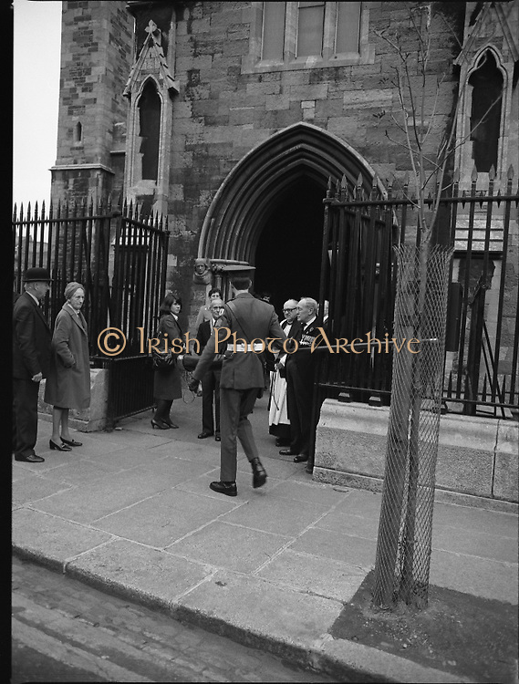 Remembrance Day Service.1983.13.11.1983.11.13.1983.13th November 1983..A remembrance service was held in St Patrick's Cathederal, Dublin,(Poppy Day) to commerate the Irish Fallen who died  whilst on service with the British Army in the two World Wars..An Irish Army N.C.O. carries a sheathed flag into the Cathedral.